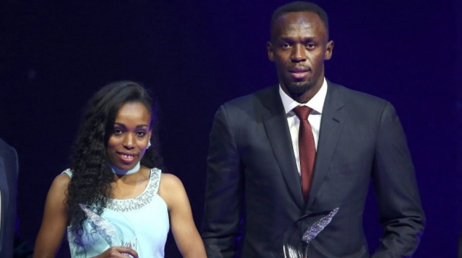 usain-bolt-of-jamaica-r-and-almaz-ayana-of-ethiopia-pose-with-their-awards-after-being-elected-male-and-female-world-athlete-of-the-year-2016-in-monaco